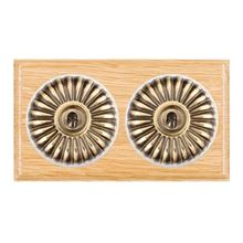Picture of 2 Gang 20AX Intermediate Toggle Switch - Fluted Dome Light Oak Ovolo Edge/ Antique Brass/ White Collars