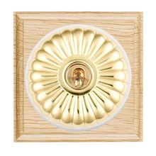 Picture of 1 Gang 20AX Double Pole Toggle Switch - Fluted Dome Light Oak Ovolo Edge/ Polished Brass/ White Collars