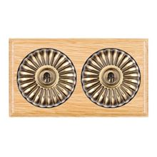 Picture of 2 Gang 20AX 2 Way Toggle Switch - Fluted Dome Light Oak Ovolo Edge/ Antique Brass/ Black Collars