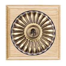 Picture of 1 Gang 20AX Double Pole Toggle Switch - Fluted Dome Light Oak Ovolo Edge/ Antique Brass/ Black Collars