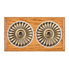 Picture of 2 Gang 20AX 2 Way Toggle Switch - Fluted Dome Medium Oak Ovolo Edge/ Antique Brass/ White Collars