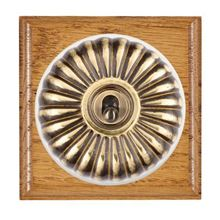 Picture of 1 Gang 20AX Double Pole Toggle Switch - Fluted Dome Medium Oak Ovolo Edge/ Antique Brass/ White Collars
