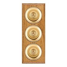 Picture of 3 Gang 20AX 2 Way Toggle Switch - Plain Dome Medium Oak Ovolo Edge/ Polished Brass/ Black Collars
