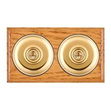 Picture of 2 Gang 20AX Intermediate Toggle Switch - Plain Dome Medium Oak Ovolo Edge/ Polished Brass/ Black Collars