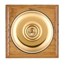 Picture of 1 Gang 20AX Double Pole Toggle Switch - Plain Dome Medium Oak Ovolo Edge/ Polished Brass/ Black Collars