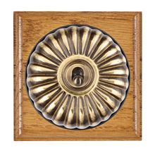 Picture of 1 Gang 20AX Double Pole Toggle Switch - Fluted Dome Medium Oak Ovolo Edge/ Antique Brass/ Black Collars