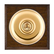 Picture of 1 Gang 20AX 2 Way Toggle Switch - Plain Dome Dark Oak Chamfered Edge/ Polished Brass/ Black Collars
