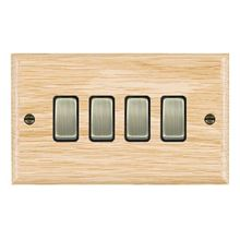 Picture of 4 Gang 10AX 2 Way Rocker / Antique Brass / Woods Light Oak Ovolo Edge with Black Surround Inserts