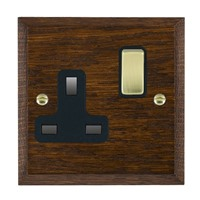 Picture of 1 Gang 13A Double Pole Switched Socket / Polished Brass / Woods Dark Oak Chamfered Edge with Black Surround Inserts