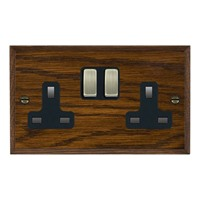 Picture of 2 Gang 13A Double Pole Switched Socket / Antique Brass / Woods Dark Oak Chamfered Edge with Black Surround Inserts