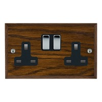 Picture of 2 Gang 13A Double Pole Switched Socket / Bright Chrome / Woods Dark Oak Chamfered Edge with Black Surround Inserts