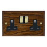 Picture of 2 Gang 13A Double Pole Switched Socket / Polished Brass / Woods Dark Oak Chamfered Edge with Black Surround Inserts