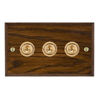 Picture of 3 Gang 20A 2 Way Toggle / Polished Brass / Woods Dark Oak Chamfered Edge with White Surround Inserts