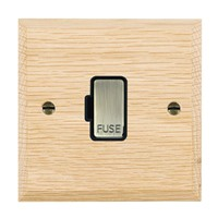 Picture of 1 Gang 13A Fuse Only / Antique Brass / Woods Light Oak Chamfered Edge with Black Surround Inserts