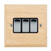 Picture of 3 Gang 10AX 2 Way Rocker / Bright Chrome / Woods Light Oak Chamfered Edge with Black Surround Inserts