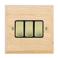 Picture of 3 Gang 10AX 2 Way Rocker / Polished Brass / Woods Light Oak Chamfered Edge with Black Surround Inserts