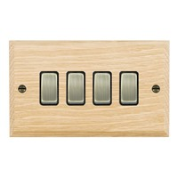 Picture of 4 Gang 10AX 2 Way Rocker / Antique Brass / Woods Light Oak Chamfered Edge with Black Surround Inserts