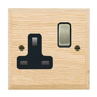 Picture of 1 Gang 13A Double Pole Switched Socket / Antique Brass / Woods Light Oak Chamfered Edge with Black Surround Inserts