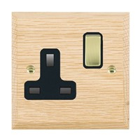 Picture of 1 Gang 13A Double Pole Switched Socket / Polished Brass / Woods Light Oak Chamfered Edge with Black Surround Inserts