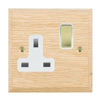 Picture of 1 Gang 13A Double Pole Switched Socket / Polished Brass / Woods Light Oak Chamfered Edge with White Surround Inserts