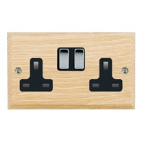 Picture of 2 Gang 13A Double Pole Switched Socket / Bright Chrome / Woods Light Oak Chamfered Edge with Black Surround Inserts