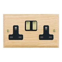 Picture of 2 Gang 13A Double Pole Switched Socket / Polished Brass / Woods Light Oak Chamfered Edge with Black Surround Inserts
