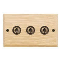 Picture of 3 Gang 20AX 2 Way Toggle / Antique Brass / Woods Light Oak Chamfered Edge with White Surround Inserts