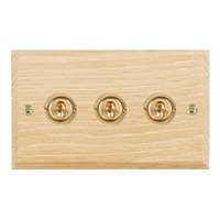 Picture of 3 Gang 20AX 2 Way Toggle / Polished Brass / Woods Light Oak Chamfered Edge with White Surround Inserts
