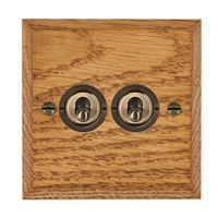 Picture of 2 Gang 20AX 2 Way Toggle Switch / Antique Brass / Woods Medium Oak Chamfered Edge with White Surround Inserts