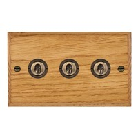 Picture of 3 Gang 20AX 2 Way Toggle Switch / Antique Brass / Woods Medium Oak Chamfered Edge with White Surround Inserts