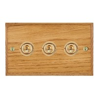 Picture of 3 Gang 20AX 2 Way Toggle Switch / Polished Brass / Woods Medium Oak Chamfered Edge with White Surround Inserts