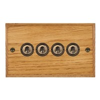 Picture of 4 Gang 20AX 2 Way Toggle Switch / Antique Brass / Woods Medium Oak Chamfered Edge with White Surround Inserts