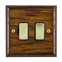 Picture of 1 Gang 13A Double Pole Fused Spur + Neon / Polished Brass / Woods Dark Oak Ovolo Edge with Black Surround Inserts