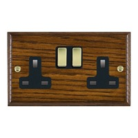 Picture of 2 Gang 13A Double Pole Switched Socket / Polished Brass / Woods Dark Oak Ovolo Edge with Black Surround Inserts