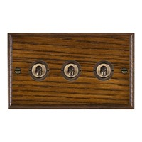 Picture of 3 Gang 20AX 2 Way Toggle Switch / Antique Brass / Woods Dark Oak Ovolo Edge with White Surround Inserts
