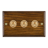 Picture of 3 Gang 20AX 2 Way Toggle Switch / Polished Brass / Woods Dark Oak Ovolo Edge with White Surround Inserts