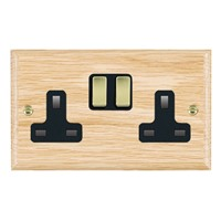 Picture of 2 Gang 13A Double Pole Switched Socket / Polished Brass / Woods Light Oak Ovolo Edge with Black Surround Inserts