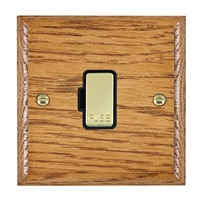 Picture of 1 Gang 13A Fuse Only / Polished Brass / Woods Medium Oak Ovolo Edge with Black Surround Inserts