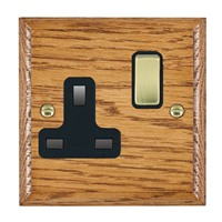 Picture of 1 Gang 13A Double Pole Switched Socket / Polished Brass / Woods Medium Oak Ovolo Edge with Black Surround Inserts