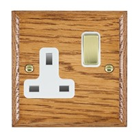 Picture of 1 Gang 13A Double Pole Switched Socket / Polished Brass / Woods Medium Oak Ovolo Edge with White Surround Inserts