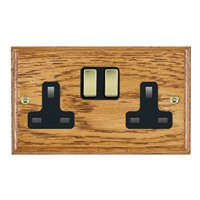 Picture of 2 Gang 13A Double Pole Switched Socket / Polished Brass / Woods Medium Oak Ovolo Edge with Black Surround Inserts