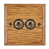 Picture of 2 Gang 20AX 2 Way Toggle Switch / Antique Brass / Woods Medium Oak Ovolo Edge with White Surround Inserts