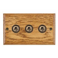 Picture of 3 Gang 20AX 2 Way Toggle Switch / Antique Brass / Woods Medium Oak Ovolo Edge with White Surround Inserts
