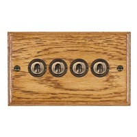 Picture of 4 Gang 20AX 2 Way Toggle Switch / Antique Brass / Woods Medium Oak Ovolo Edge with White Surround Inserts